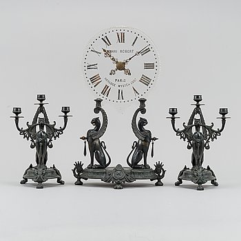 A French glass dial Mystery Clock and a pair of candelabras, late 19th century.