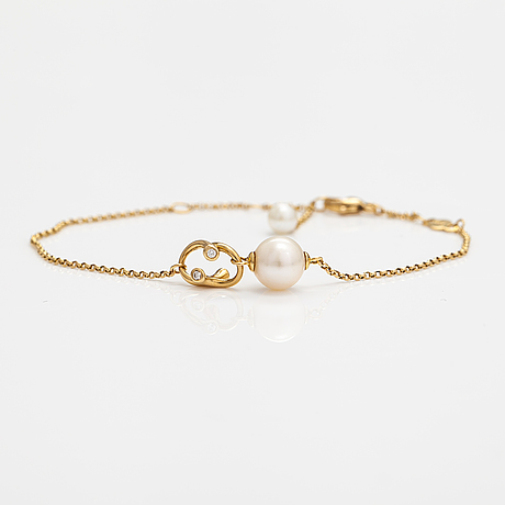 """Georg jensen, an 18k gold bracelet """"magic"""" with a cultured pearl and diamonds ca. 0.048 ct in total, denmark."""