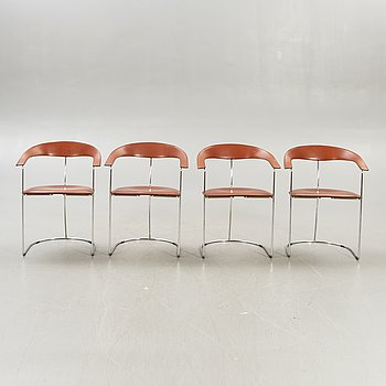 A set of four leather and chrome Arrben Ursula armchairs Italy 1980s.