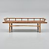 A wooden daybed, south east asia.