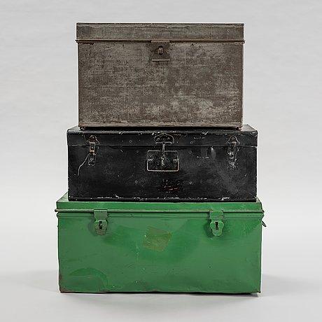 A set of 3 metal boxes.