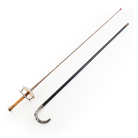 A mid-20th century foil and a walking stick.