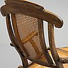 A stained wood and rattan deck chair, first half of 20th century.