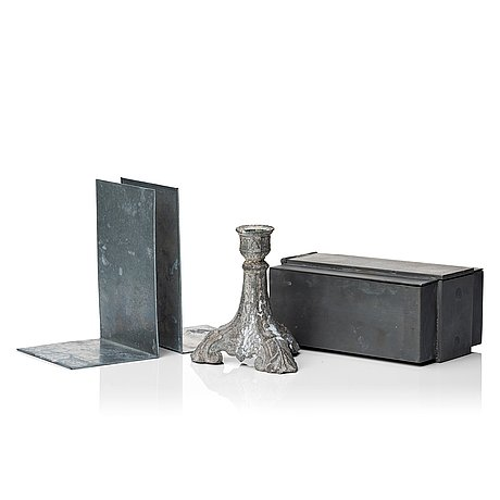 A pair book ends, candlestick and metal box from parts of four.