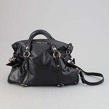 Miu Miu, a calf leather handbag.