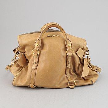 Miu Miu, a leather handbag.
