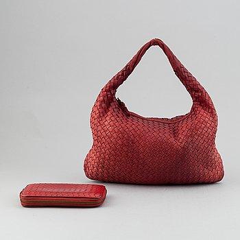 Bottega Veneta, a red intrecciato leather hobo bag and a wallet.