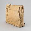 Chanel, a beige leather handbag, 1986-1988.
