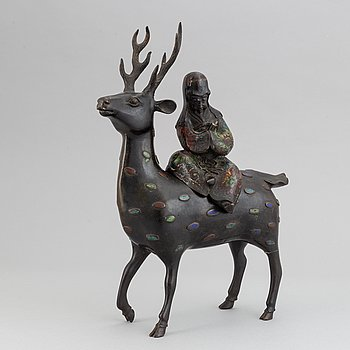 A bronze and enamel cencer in the shape of Shoulao on his deer, late qing dynasty 19th/20th century.