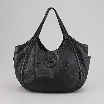Tory Burch, a leather handbag.