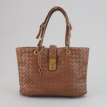 Bottega Veneta, a brown intrecciato leather handbag.