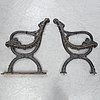 A pair of cast iron garden sofa sides.