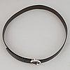 Cartier, a black leather belt.