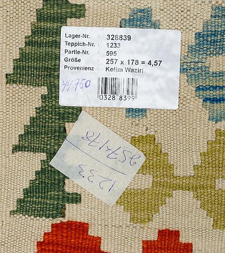 A rug, kilim, ca 257 x 178 cm.