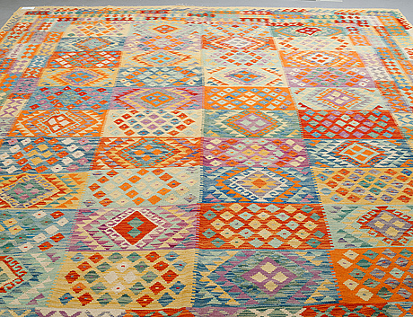 A carpet, kilim, ca 400 x 308 cm.