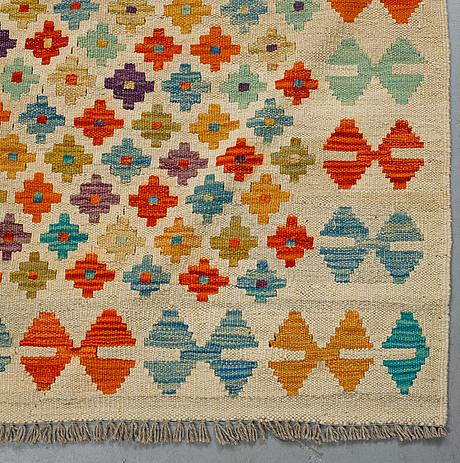 A carpet, kilim, ca 238 x 174 cm.