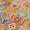A carpet, kilim, ca 393 x 297 cm.