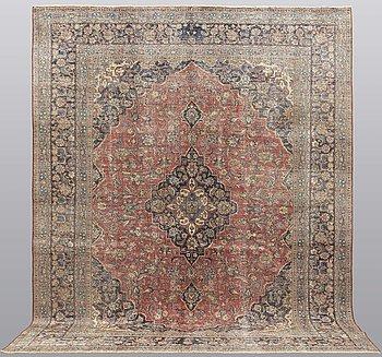 An oriental carpet ca 385 x 300 cm.