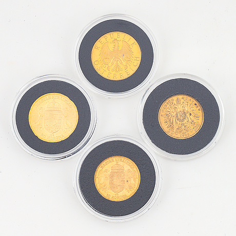 Four austrian and hungarian gold coins.