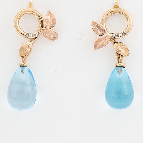Blue topaz and brilliant-cut diamond earrings.