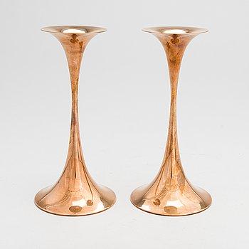 "Tapio Wirkkala, A pair of brass ""Trumpet"" candlesticks, stamped Tapio Wirkkala, Hopeakeskus Oy Made in Finland."
