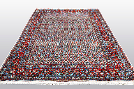 A carpet, moud, ca 304 x 196 cm.