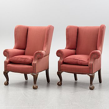 A pair of  Wingback chairs, first half of the 20th Century.