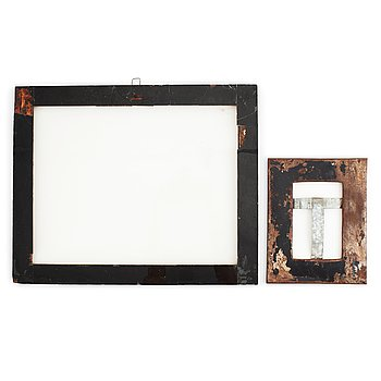 A set of two contemporary metal frames.