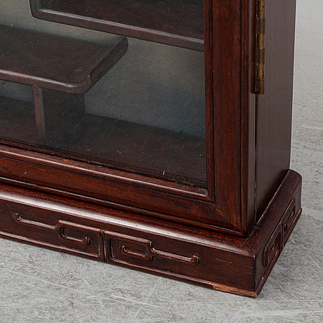 A chinese 20th century hardwood wall cabinet.