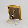 A brass and enamel photo frame, early 20th century.
