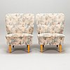 A pair of 1950's armchairs.