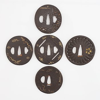 Five iron tsubas, one signed, Edo period.
