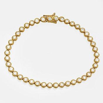 Armband, 18K guld med 42 briljanter 2,94 ct totalt, längd ca 20 cm, AIG certificate 2018.