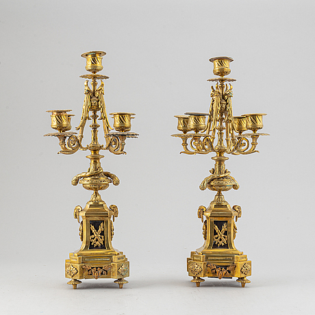 Mantle clock and a pair of candelabra.