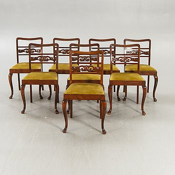 A set of eight Empire style mahogany chairs.