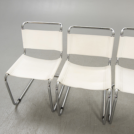 A set of four italien chrome and leather chairs later part of the 20th century.