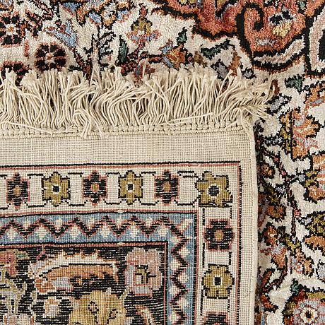 An old silk kashmir carpet ca 263 x 179 cm.