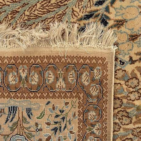 A semiantique part silk nain carpet ca 265 x 163 cm.