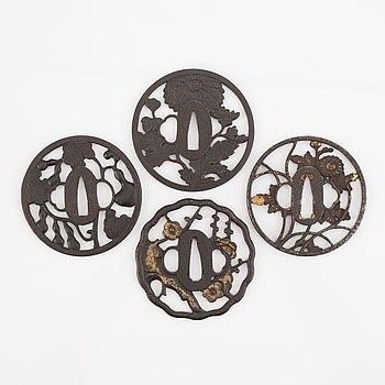 Four iron Tsubas, Edo-period, one signed.
