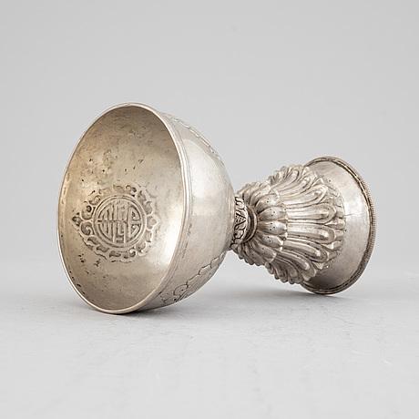 A tibetan butter lamp, silvered copper, 20th century.