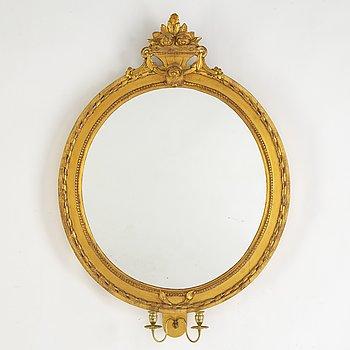 A Gustavian two-light girandole mirror, late 18th Century.