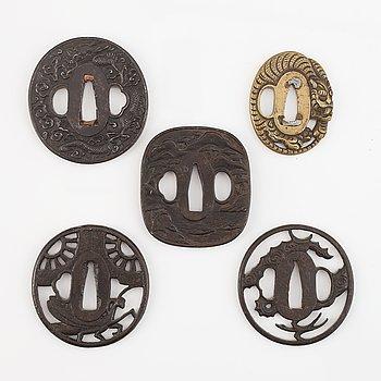 Five tsubas, iron and brass, Edo/Meiji period.