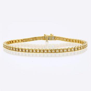 Tennisarmband 18K guld med briljanter ca 0,90 ct totalt, längd ca 19 cm.