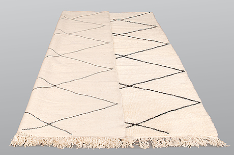 A moroccan carpet, 306 x 222 cm.