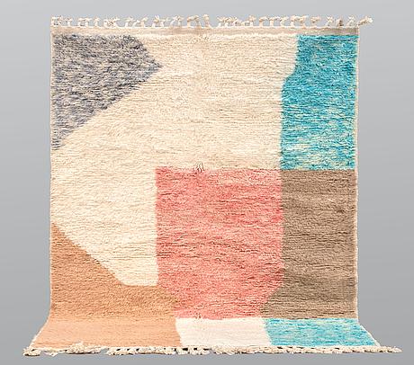 A moroccan carpet, 238 x 150 cm.
