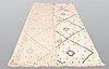 A moroccan carpet, 288 x 175 cm.
