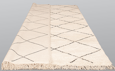 A moroccan carpet, 358 x 245 cm.