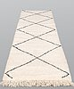 A moroccan runner carpet, 300 x 88 cm.
