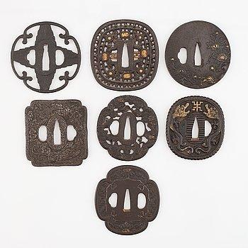 Seven tsuba of different origin, 18th - 20th Century.