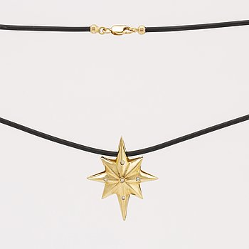 Pendant on latex, 18K gold with brillliant-cut diamonds approx 0,03 ct, pendant not removable, length approx 40 cm.